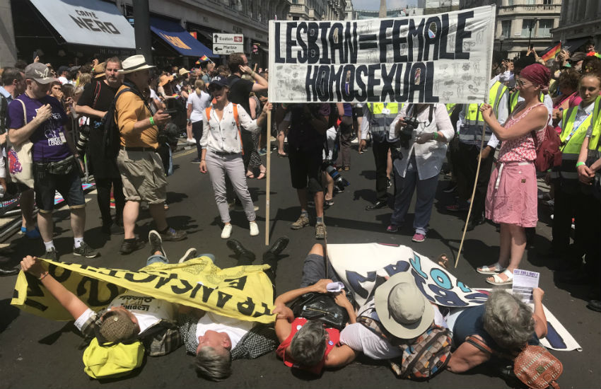 Lesbian activists storm and block the Pride in London parade route