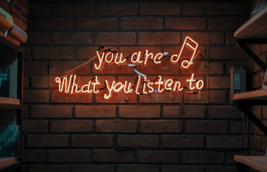 Neon sign about listening to things