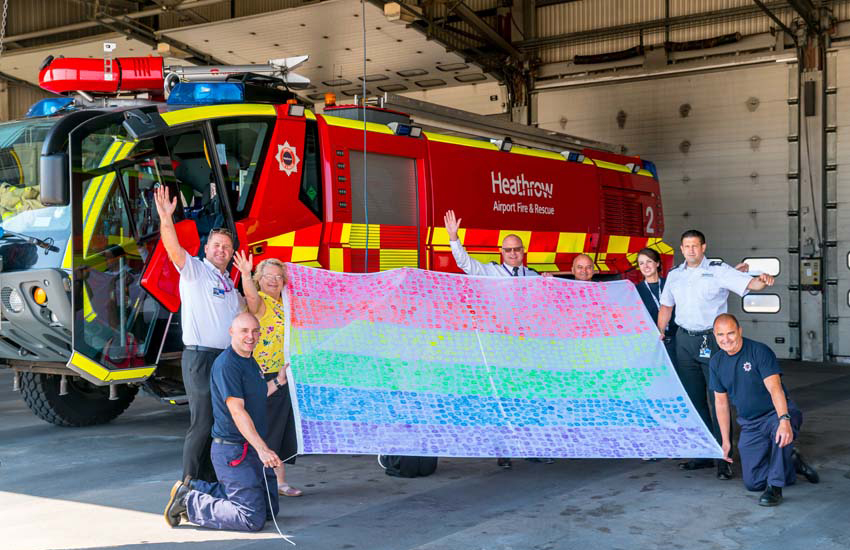 The Heathrow Airport pride flag visits the fire department