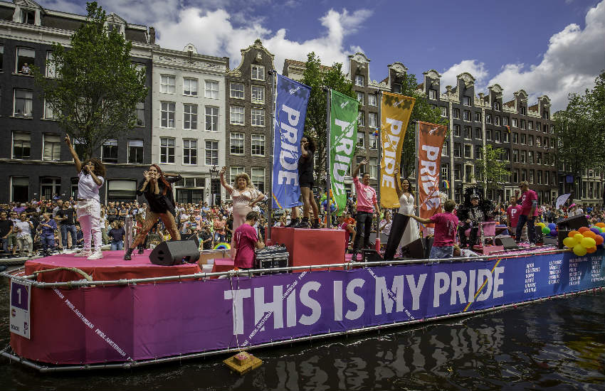 Dancers on a Pride barge down Amsterdam's canal.