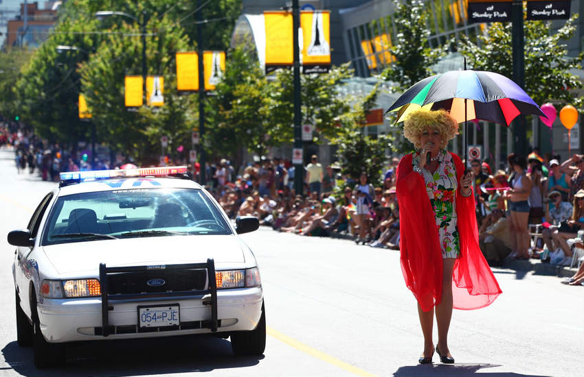 A drag queen walking the Vancouver Pride Parade.
