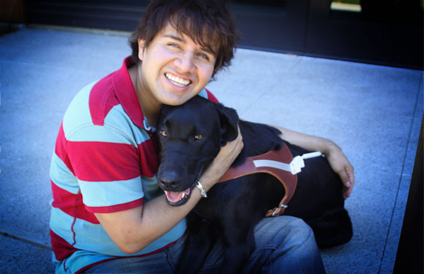 Belo Cipriani (pictured here with his guide dog, Oslo) is developing a book by and for people with disabilities