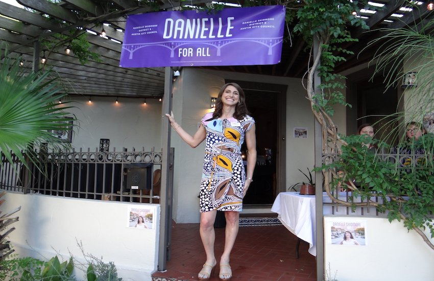 Danielle Skidmore poses under a campaign sign