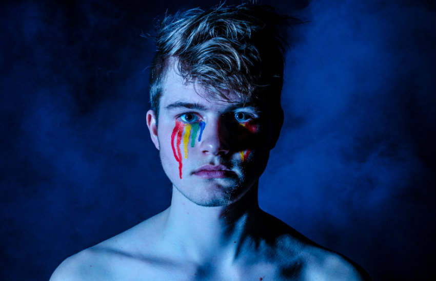 A person with rainbow tears