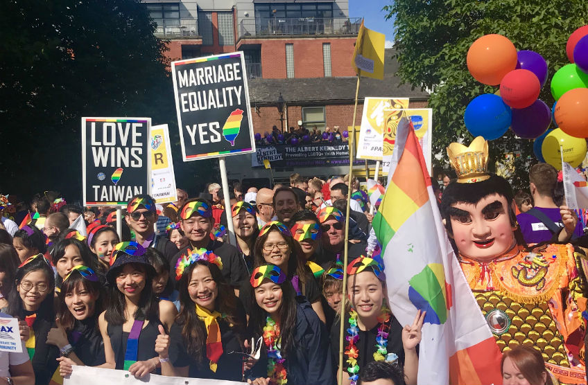 People at Manchester Pride holding placards in support of marriage equality for taiwan
