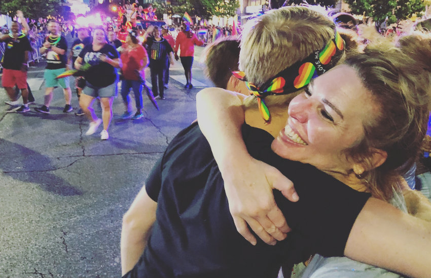 Jen Hatmker giving a free mom hug to someone at Austin Pride