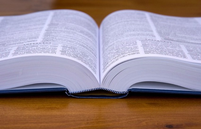 an open dictionary lying on a table