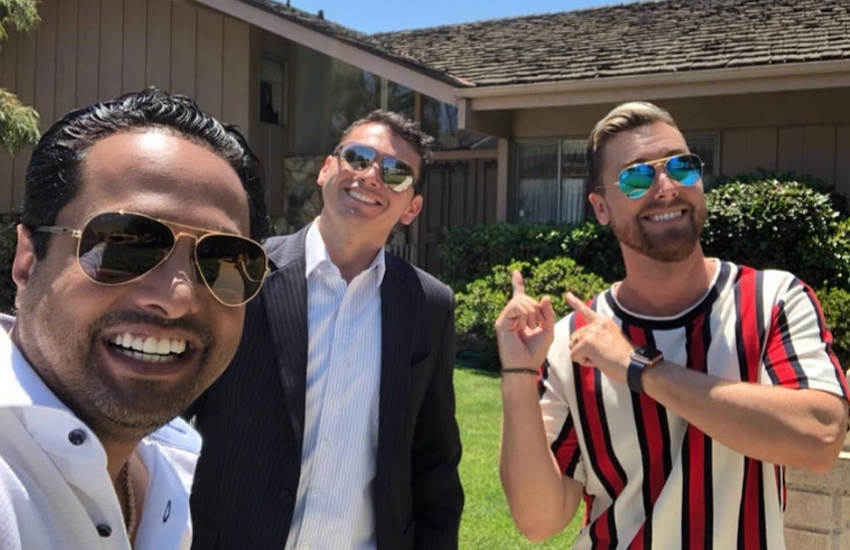 Lance Bass and his husband and friend outside the Brady Bunch house