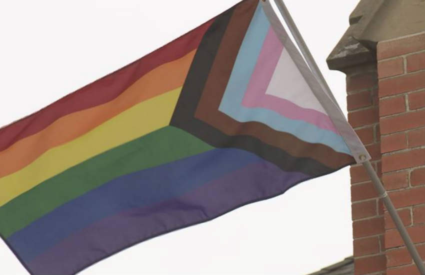 The new flag featuring the classic six stripes and a triangle on the hoist with light blue, light pink and white and brown and black stripes to include trans and people of color.