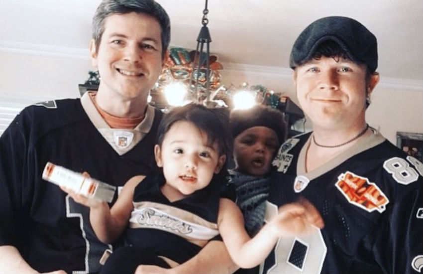 Erik (right), husband Douglas (left), and their two daughters