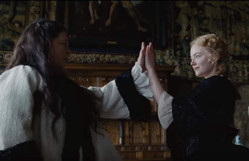 Olivia Colman as Queen Anne and Emma Stone as Abigail dancing.