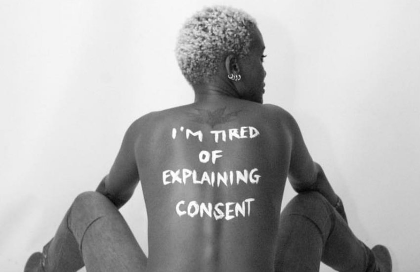 Woman with 'I'm tired of explaining consent' painted on her back