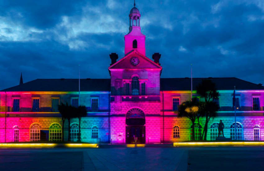 Ards Town Hall lit up in rainbow colors.