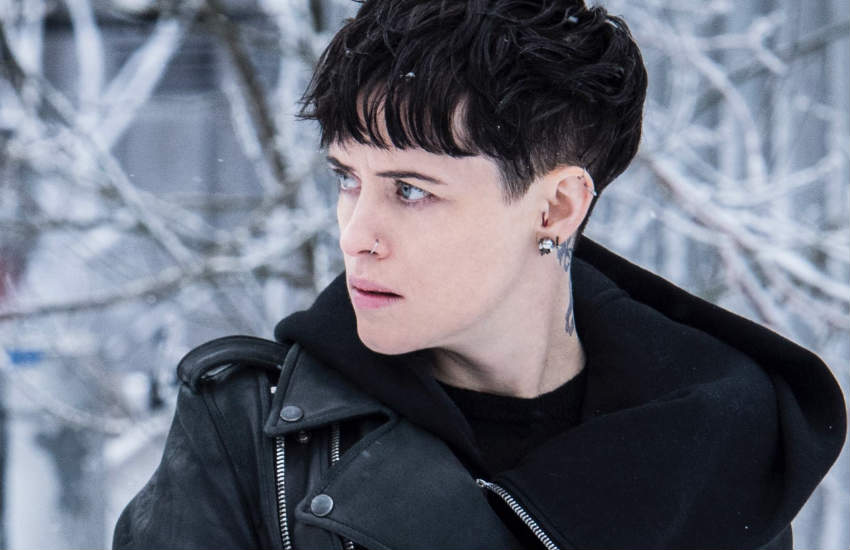 Claire Foy sporting black hair and a tattoo on her neck for the role of Lisbeth Salander.