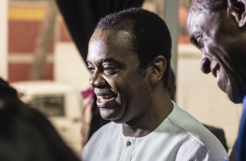 aside shot of donald duke who looks like he is listening to someone speak and he is smiling