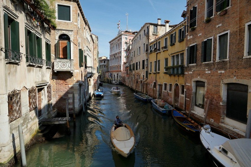 A photo of a a Venice canal on a sunny day