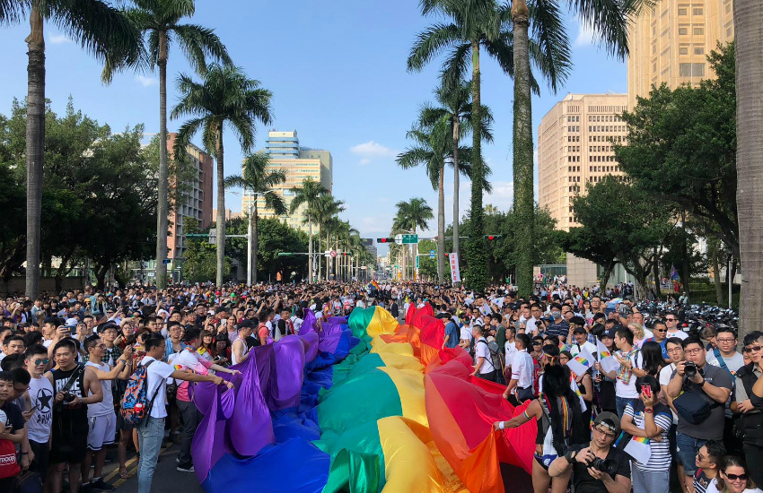 A giant rainbow flag leads one of the parade routes (Photo: Rik Glauert)