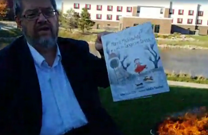 Iowa man burns lgbti books