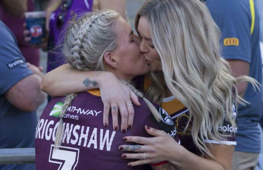 Ali Brigginshaw kisses Kate Daly after the match.