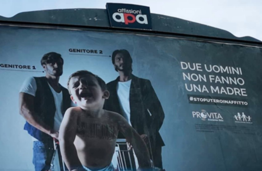 A billboard in Rome says 'two men don't make a mother, there are two men standing behind a crying baby