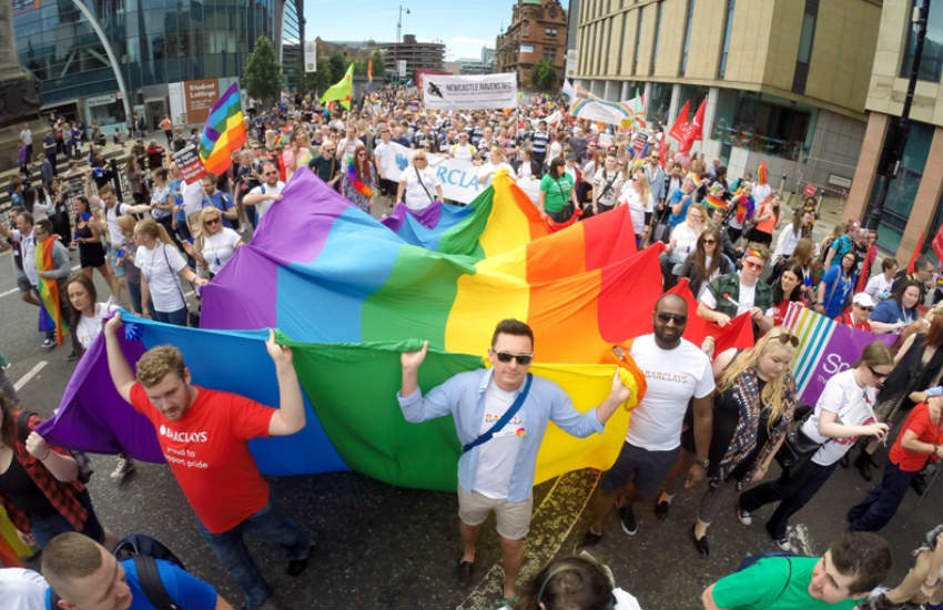 Marchers waving the rainbow flag at Northern Pride.