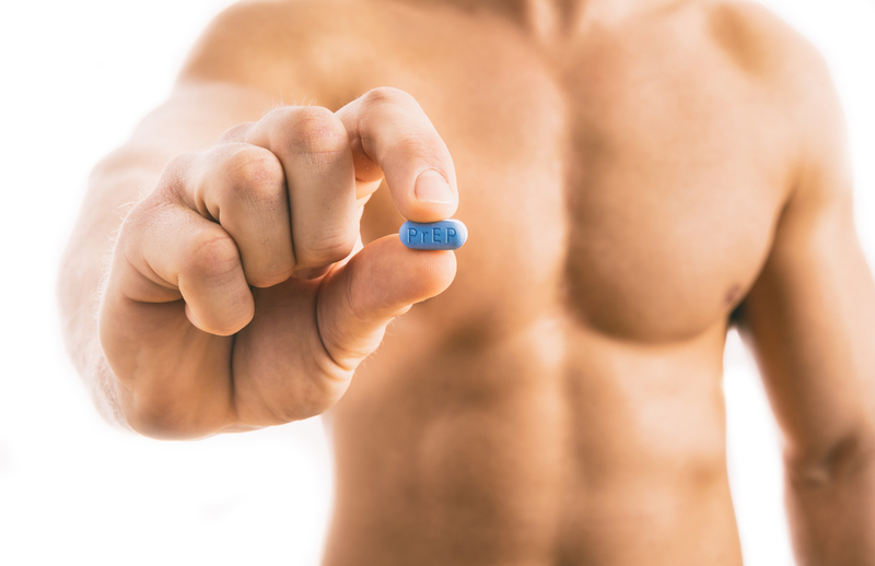 A man holds a PrEP (Truvada) pill to prevent acquiring HIV
