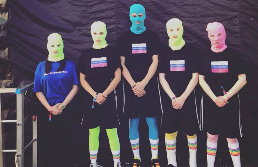 five people in coloured balaclavas and t-shirts with russian flags