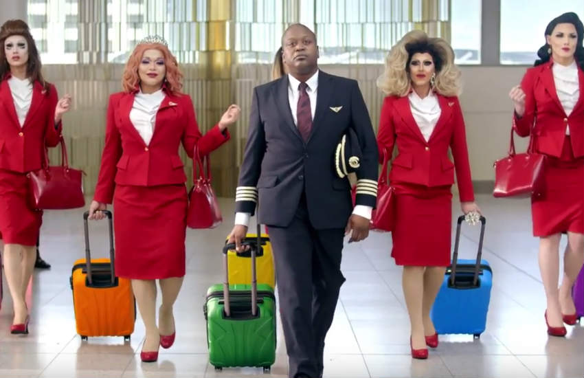 Tituss Burgess and his rainbow crew will fly you to next year's World Pride.