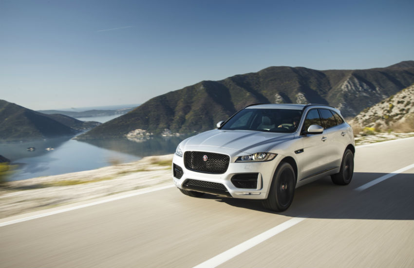 Jaguar F-Pace driving in the countryside.