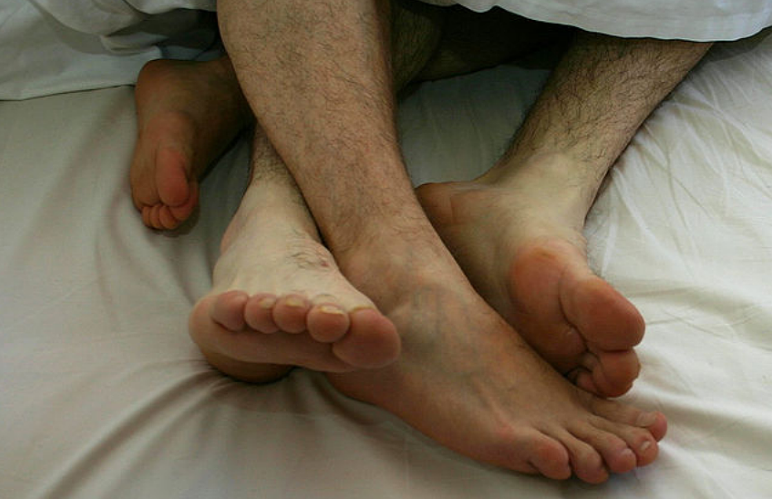 People in bed together