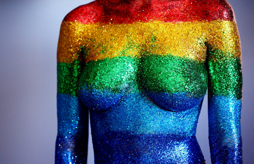 A body covered in rainbow paint and glitter