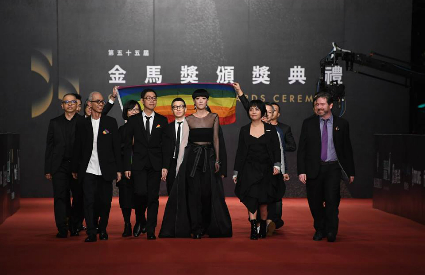 Judges of Taiwan's Golden Horse Awards walk down the red carpet flying a rainbow flag (Photo: Facebook)