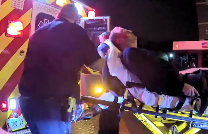 Victim Tom Stacha going into an ambulance after the attack in Chicago