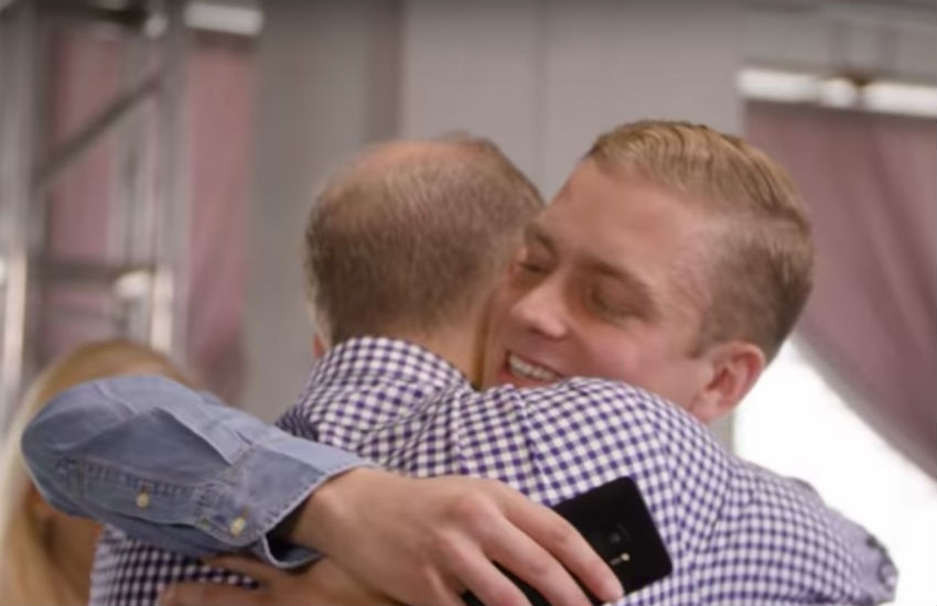 Young gay man John hugs his father after coming out as gay