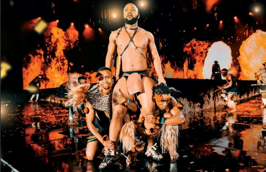 South African rapper Cassper Nyovest performing onstage in traditional south african wear