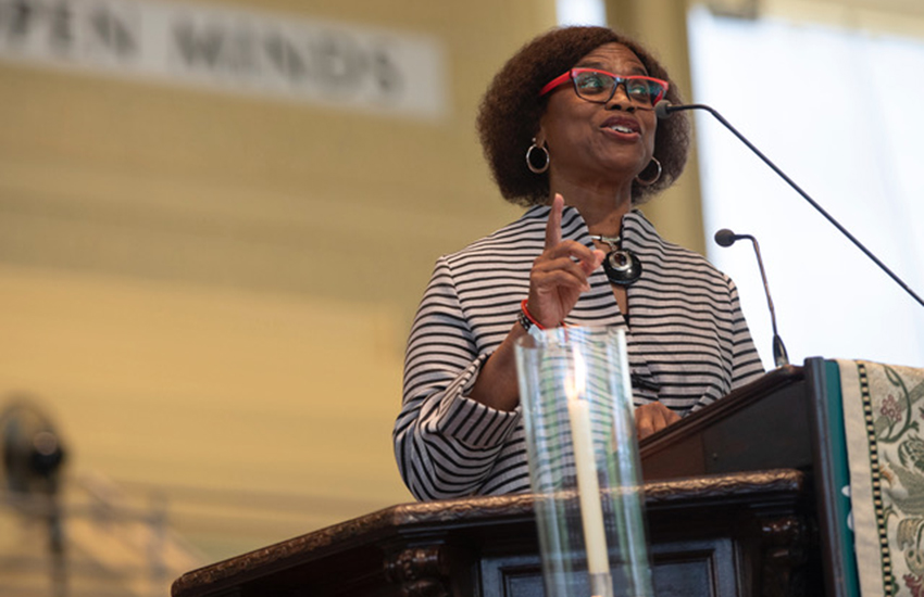 racist Rev Irene Monroe leading worship in the summer of 2018.