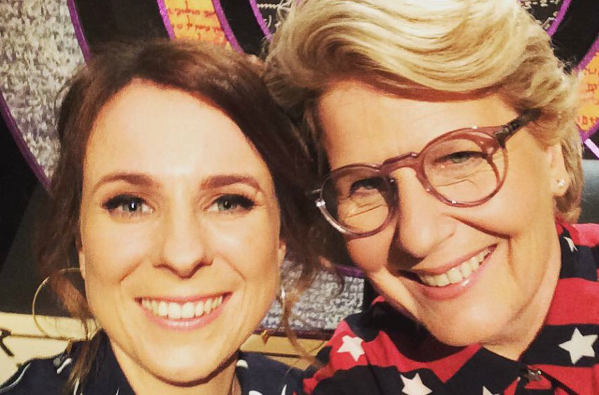 two women doing a selfie and smiling close up on the set of QI