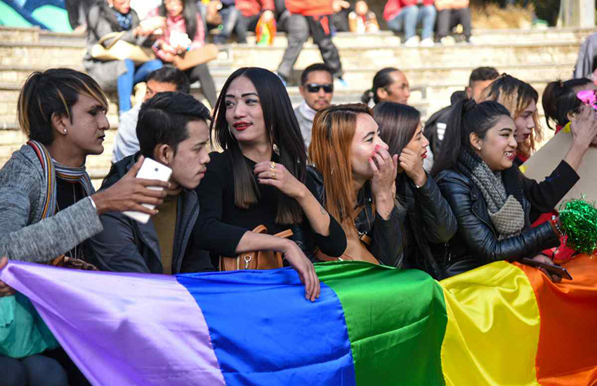LGBTI and allies in India hold a rainbow flag