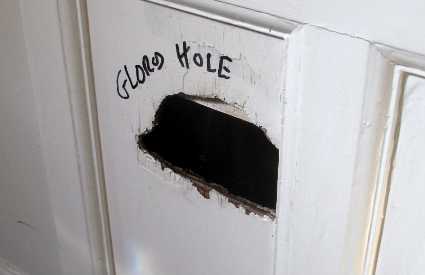 A hole in a wall labeled a 'glory hole'