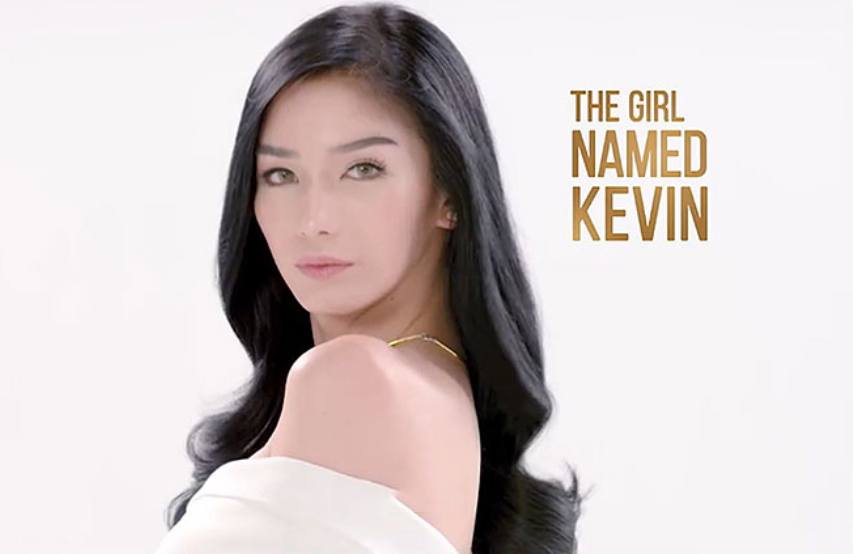 kevin balot looking over her left shoulder wearing a white strapless dress, her long black hair is shiny, there is writing next to her head that reads the girl named kevin