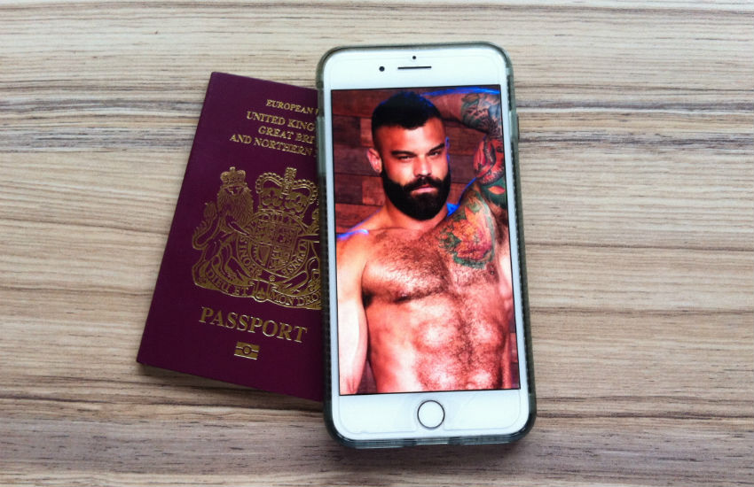 A passport and a cellphone with a porn performer