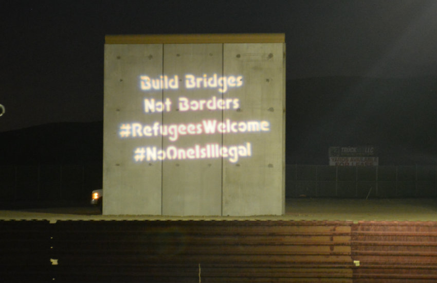 A message projected onto a prototype of Trump's wall