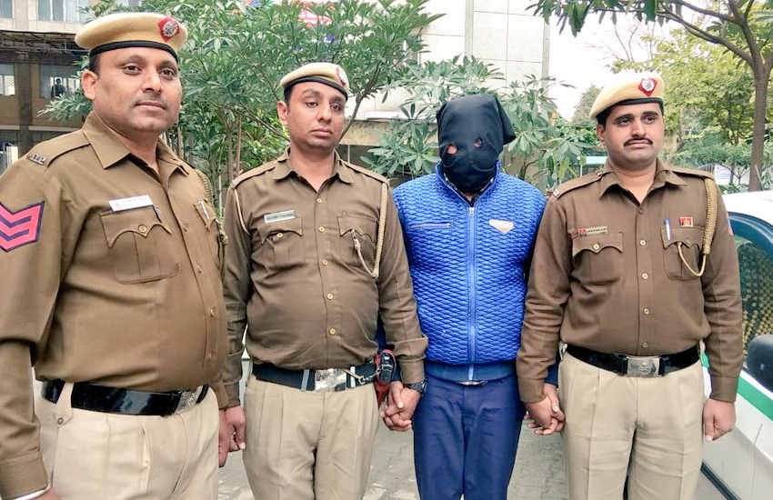 Delhi police with suspect (in blue) in killing of trans woman (Photo: Delhi Police / Twitter)