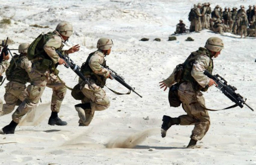 us troops running in the sand