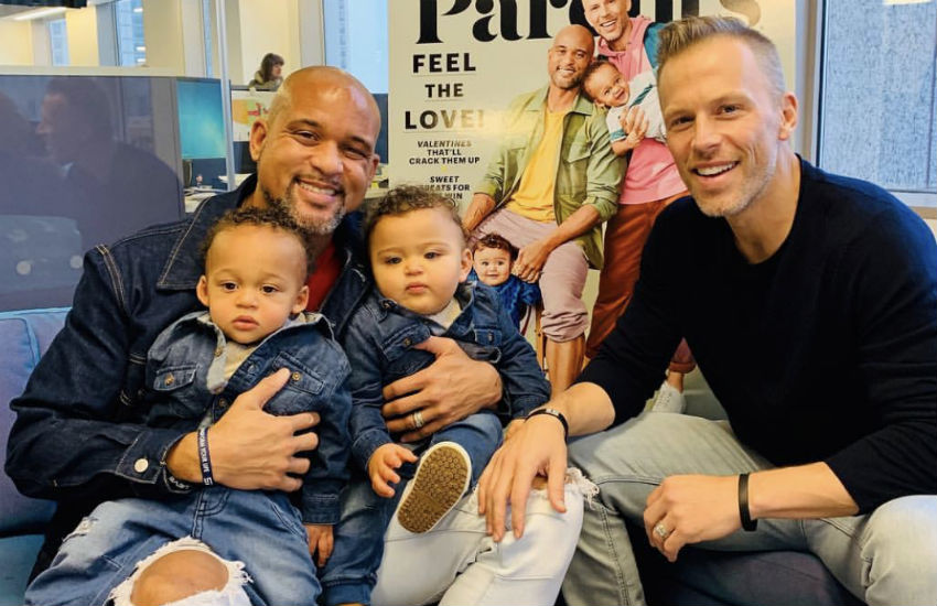 Shaun T and Scott Blokker with their twin sons