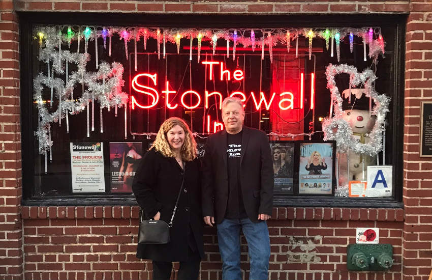 Kurt Kelly and Stacy Lentz posing in front of the Inn.