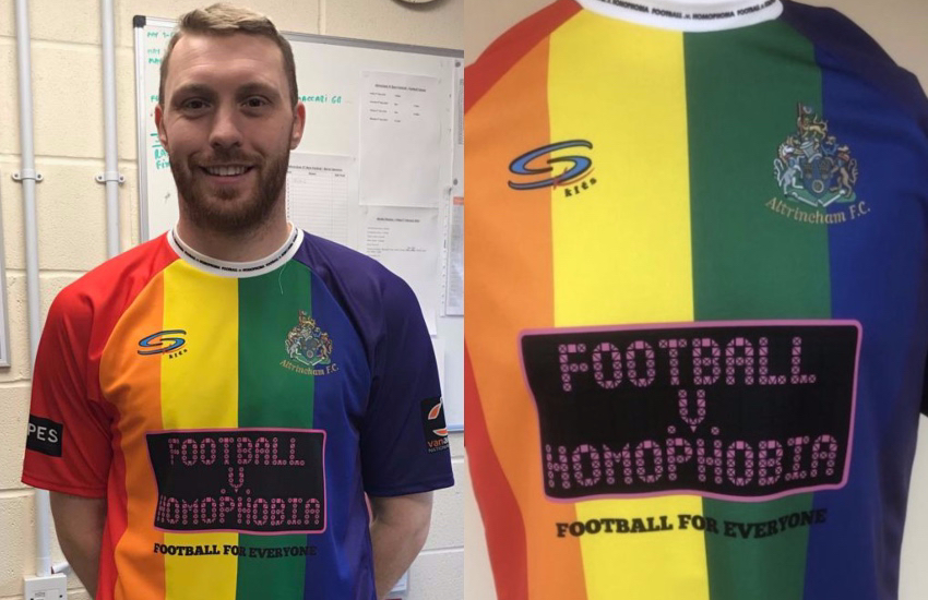 An Altrincham FC player wears a jersey with a Pride flag design.