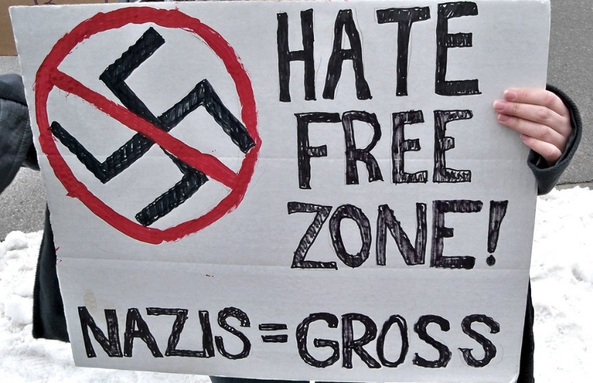 Person holding an anti-nazi sign