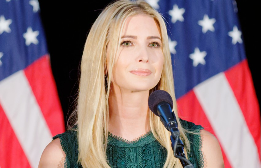 Ivanka Trump in front of an American flag