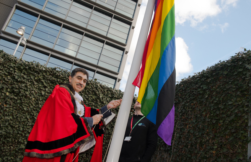 Mayor of Brent Cllr Arshad Mahmood raises the LGBT+ flag, with a seventh black stripe, at Brent Civic Centre